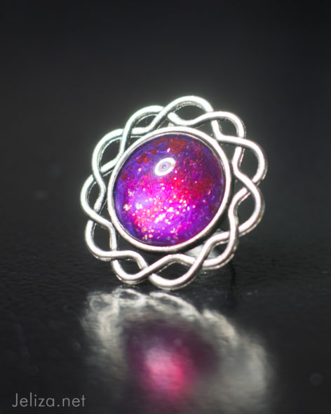 magenta cocktail ring with silver swiirl